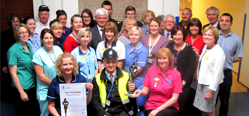 • Group of staff celebrate receiving the award
