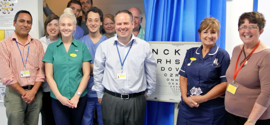 Phil Smith, the new Eye Clinic Liaison Officer at Torbay Hospital (centre), with healthcare professionals from the Eye Care team.