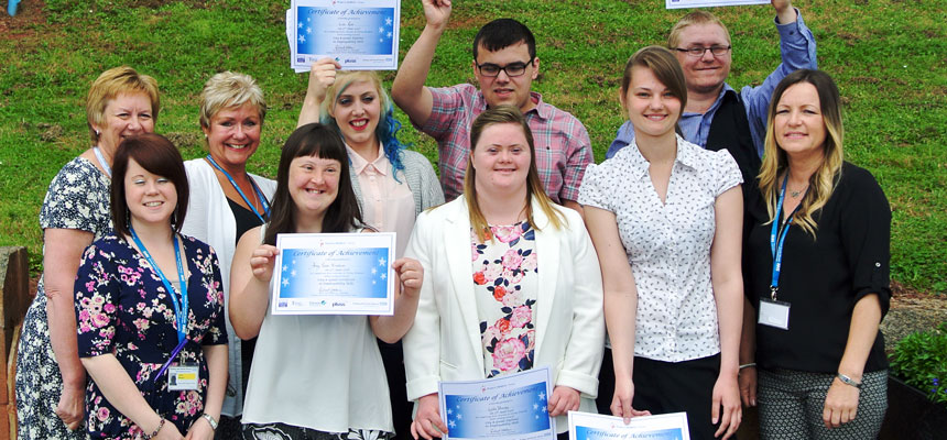 Staff with graduates from the Project SEARCH internship scheme based at Torbay Hospital