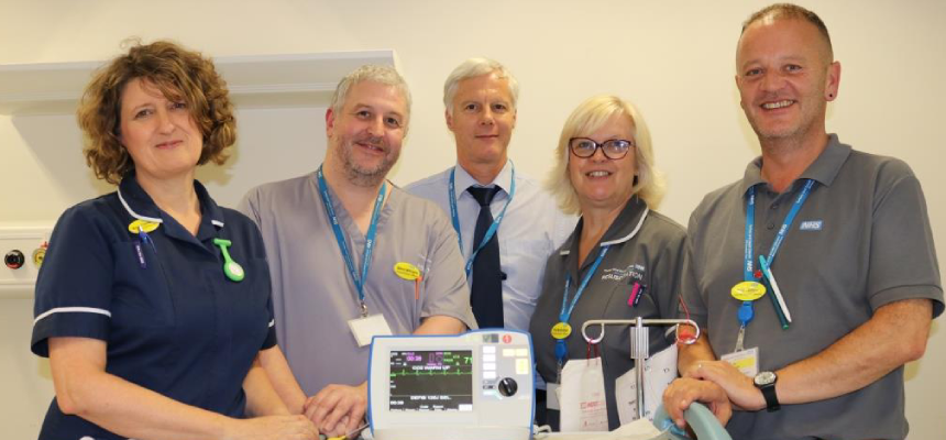 Megan Clemence, Trust Resuscitation Lead with others standing beside a new defibrillator