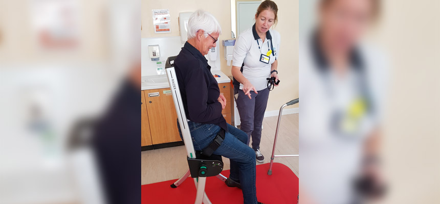 Photo featuring staff and patient using a new Raizer Chair