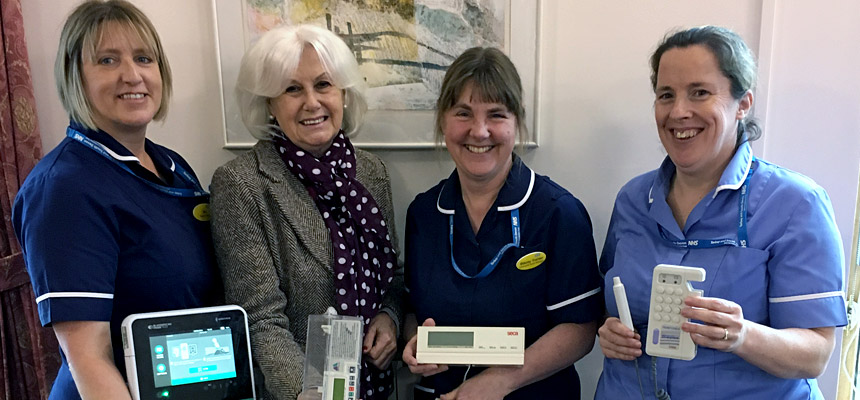 Photo - left to right: Nicola Shaw (Community Nurse Team Leader), Avril Kerswell (Chair of Bovey Tracey League of Friends), Stacey Tranter (Community Nurse Manager) and Sarah Young (Community Nurse)