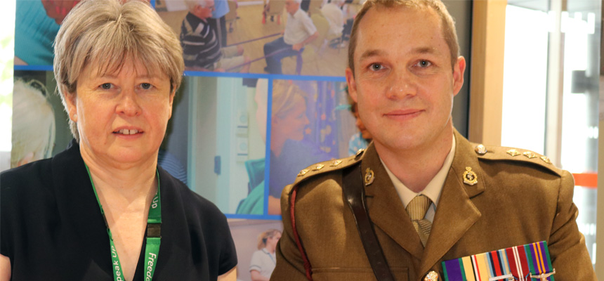 Photo: Chief Executive Liz Davenport and Captain Ben Kirby (of 243 (Wessex) Field Hospital (the local Army Reserve Medical Unit)