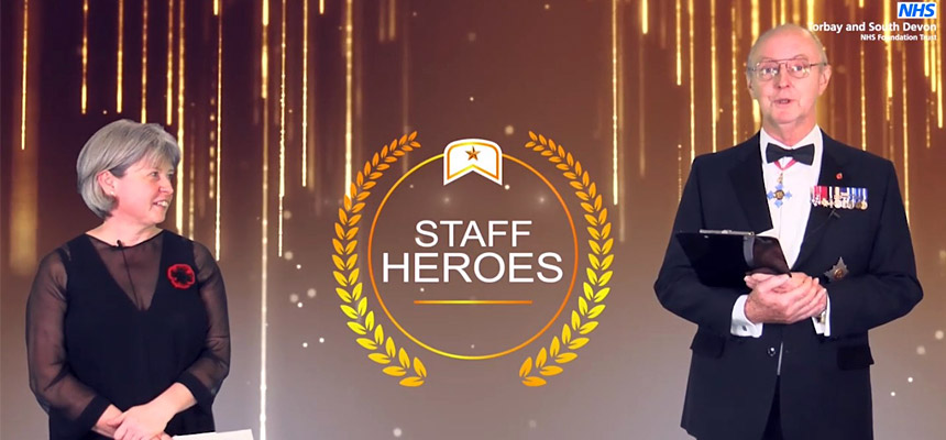Photo: Liz Davenport (CEO) and Sir Richard Ibbotson (Chair) presenting the Annual Staff Heroes Awards