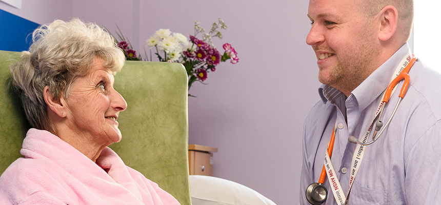 Photo: Dr talking with smiling patient