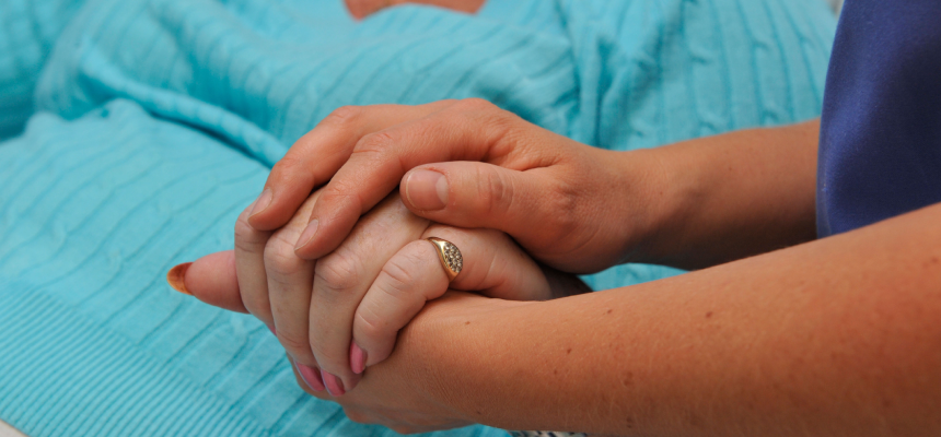 Image of a hand being held by another person